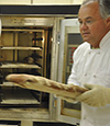Image of Andrew Ross, Professor, baking bread; split appointment OSU Crop and Soil Science and Dept. of Food Science and Technology
