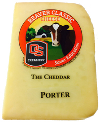 Wedge of the Porter Soaked Cheddar variety of Beaver Classic Cheese