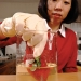 Dr. Yanyun Zhao, OSU food scientist, coats fresh strawberries with a thin, antimicrobial, edible film made from egg white and crab shell. Photo credit: Lynn Ketchum © 2004 Oregon State University
